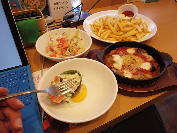 French Fries Abocado Salad Yummy Tasty Taste Good Delicious Eating Eat Restaurant Breakfast Lunch Meal Time Dishes Notebook Laptop Working Holiday Internet Business Food And Drink Food Table Ready-to-eat Freshness High Angle View Human Hand Indoors  Plate Hand Unrecognizable Person Human Body Part Kitchen Utensil Fast Food One Person Healthy Eating Real People Potato Wireless Technology Meal Tray Snack