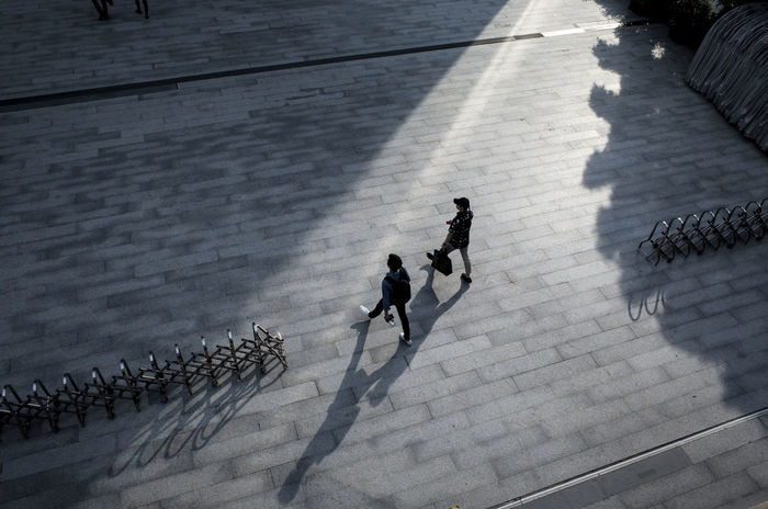 High angle view of people walking on footpath
