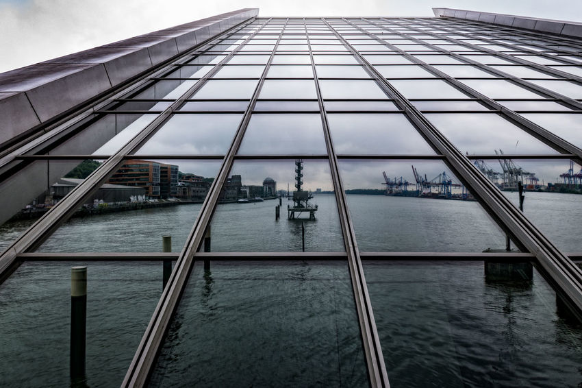 Dockland Architecture Bridge - Man Made Structure Building Exterior Built Structure City Day Dockland Elbe River Hamburg Harbour Men Nautical Vessel Occupation One Person Outdoors People Photography Themes Real People Reflection River Sky Standing Transportation Water Women