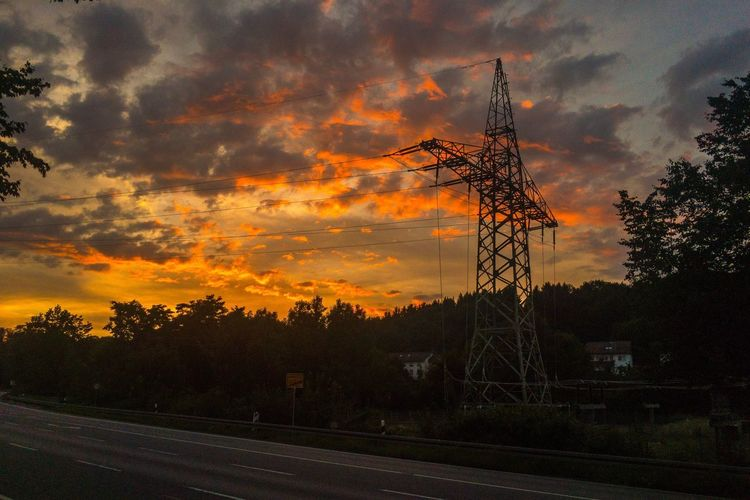 On my way to work. Sunset Tree Cloud - Sky Orange Color Sky Silhouette No People Nature Outdoors Electricity Pylon Technology Road Beauty In Nature Scenics Day Power Lines Power Supply Electricity Pole Electricity Tower Pylons Pylons And Power Lines The Week On EyeEm