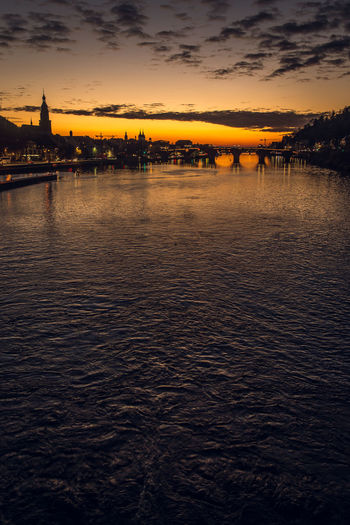 Scenic view of river against sky during sunset