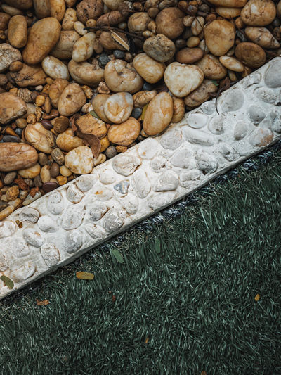 High angle view of pebbles on field
