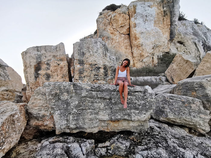 Girl in front of the rock