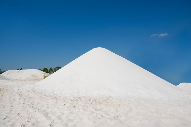 View of sand against blue sky