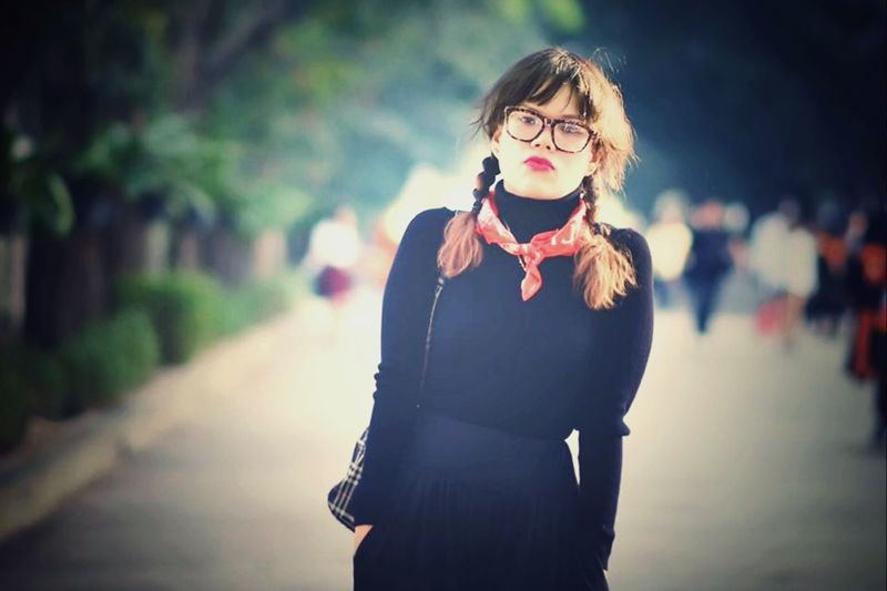 One Person Real People Young Adult Front View Focus On Foreground Standing Looking At Camera Women Clothing Lifestyles Young Women Beautiful Woman Glasses Leisure Activity Scarf Adult Hairstyle Outdoors Day Portrait
