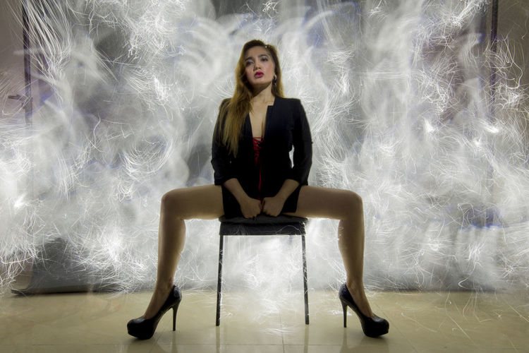 Portrait of young woman sitting on seat