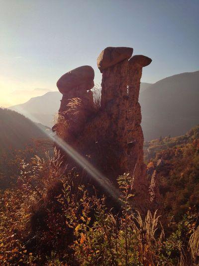 Rock formations against sky at piramidi di segonzano trento on sunny day