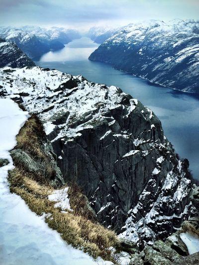 Lake along snow covered landscape