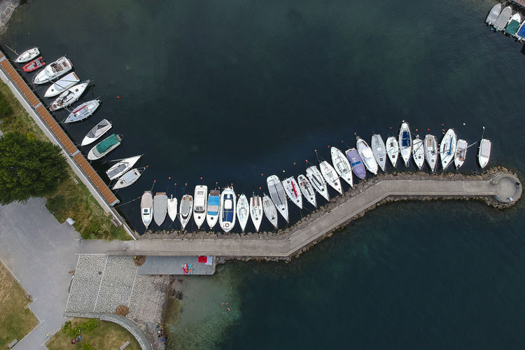 Aerial view of a dock with moored boats