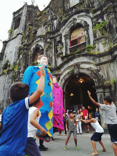 Kids teasing the higantes in Lucban Higantes Lucban City Men Tree Women Togetherness Friendship Architecture Building Exterior Cathedral Tourism Tourist Attraction  Famous Place