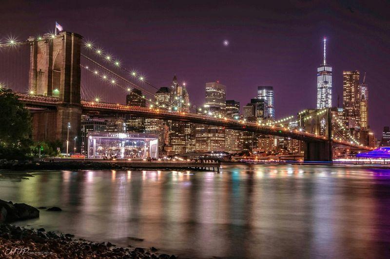 View of Brooklyn Bridge and Manhattan at night, New York City, New York State, USA