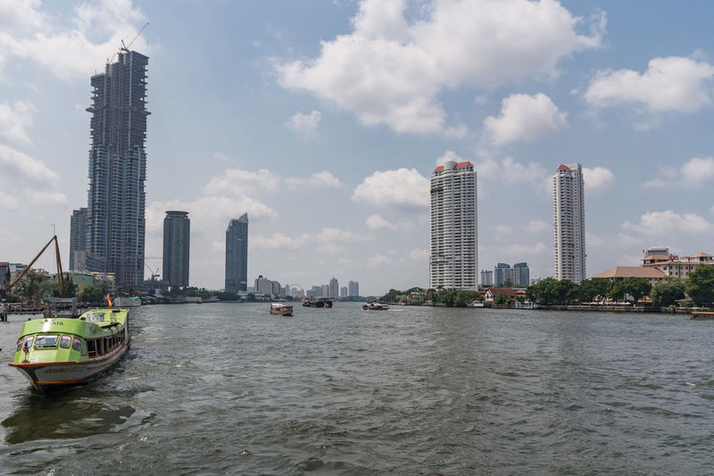 Bangkok Bangkok Thailand. Architecture Bay Building Building Exterior Built Structure City Cityscape Cloud - Sky Financial District  Mode Of Transportation Modern Nautical Vessel No People Office Building Exterior Outdoors River Sky Skyscraper Tall - High Tower Transportation Water Waterfront