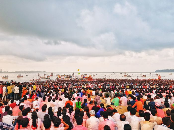 In India Maharashtra there is a Ganesh Puja (Idiol worship) festival which last for almost 11days, People submitted there self to Lord Ganesha and worshipping all day. After 1st day, 5th day, 9th day and 10th day they immersed Idiol in a Ocean or lake which is a kind of farewell to a Lord who came to there home and gave blessings. Happily immersion also symbolises that lord will come to next year again. Large Group Of People Sky Crowd Water Sunset Beach Day Outdoors Sea Horizon Over Water People Fan - Enthusiast Representing Immersion Lord Lord Ganesha Ganesha GaneshChaturthi Ocean Sunrise EyeEm Best Shots EyeEmBestPics