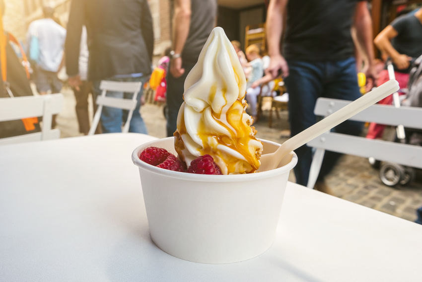 Frozen Yogurt on a table in pedestrian zone of city Blurred City Spoon Focus On Foreground Food Food And Drink Freshness Frozen Food Frozen Yogurt Fruits Healthy Eating Hipster Honey Ice Cream Ice Cream Cone Outdoors People Raspberry Ready-to-eat Real People Street Sweet Food Table Temptation Toppings