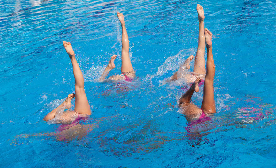 Synchronized swimmers' legs stretched out in the pool. Water Dance Water Sport Women Sports Clear Blue Water Competition Competitive Sport Coreography Legs Legs And Feet Legs Stretched Out Pool Repetitive Sport Strength Swimmers Swimming Swimming Pool Swimming Pool Water Synchronized Synchronized Swimming Team Sport United Water Water Ballet Women Legs