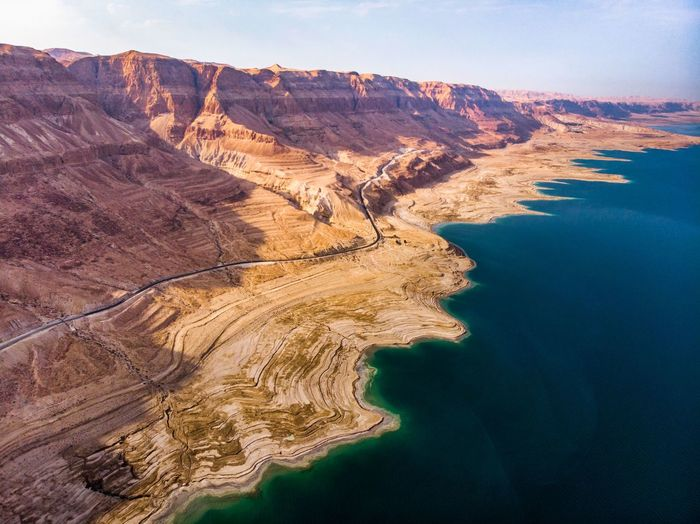 Beauty In Nature Scenics - Nature Rock Water Rock Formation Rock - Object Tranquility Tranquil Scene Non-urban Scene Nature Land Mountain No People Solid Travel Destinations Day Landscape Cliff Travel Outdoors Eroded Formation Bay Dead Sea  Desert Salt Israel Aerial Photogrammetry Dronephotography