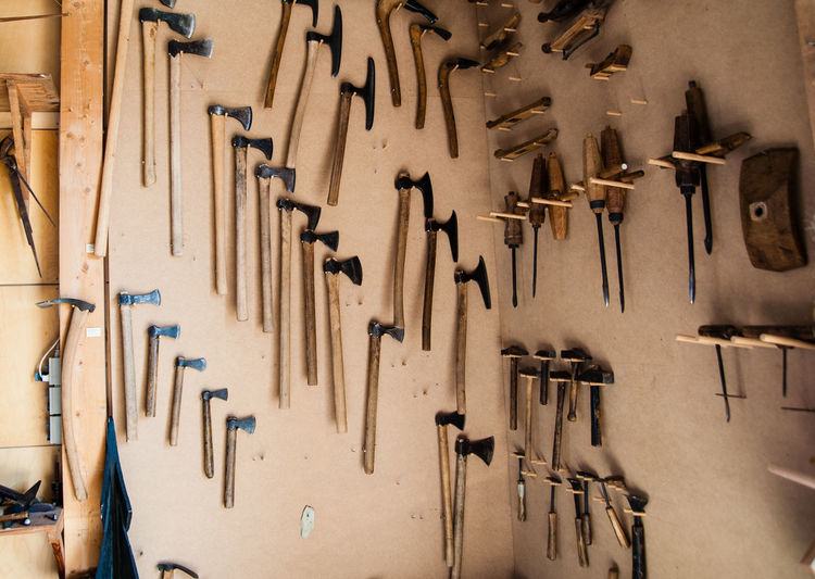 Close-Up Of Tools Hanging On Wall
