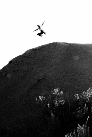 Flying Outdoors Blackandwhite Jump Desert Black And White Jumping Mid-air Low Angle View One Person Insect Day EyeEmNewHere New Talent