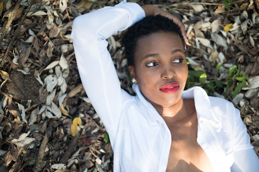 seasons African Adult Beautiful Woman Change Close-up Day Headshot Leaf Lifestyles Looking At Camera Nature One Person One Young Woman Only Outdoors People Portrait Real People Standing Tree Young Adult Young Women