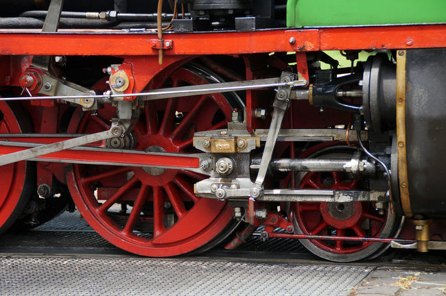 Detail of a historic narrow-gauge railway. The connecting rod drives with their translation to the large driving wheels. A symbol of steam power, the technological revolution of the 19th century and for nostalgia for fans of steam locomotives. Engine Historic Land Vehicle Old Railroad Steam Locomotive Steammachine Transportation Travel