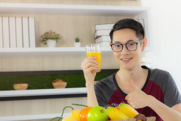 Portrait of smiling man holding food