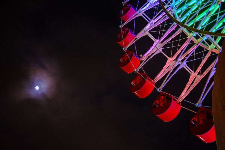 Night ferris wheel. Okinawa, Japan. Japan Moon Okinawa Amusement Park Amusement Park Ride Arts Culture And Entertainment Enjoyment Ferris Wheel Fujifilm Fujifilm_xseries Illuminated Leisure Activity Low Angle View Lunar Moonlight Multi Colored Night Nightlife No People Outdoors Sky Spinning