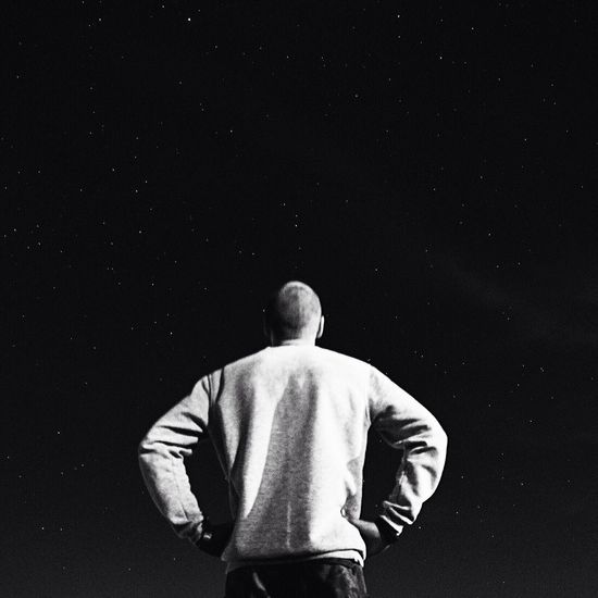 Rear View Night Astronomy Black Background One Person Standing Men Real People Outdoors One Man Only Space Galaxy Sky Young Adult People Black And White Friday