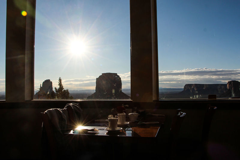 Sky Sunlight Lens Flare Sun Nature Sunbeam Window Indoors  Table Glass - Material Day Architecture No People Transparent Built Structure Illuminated Reflection Food And Drink Tranquility Luxury Streaming Monument Valley Arizona Landscape Arizona Morning Tea