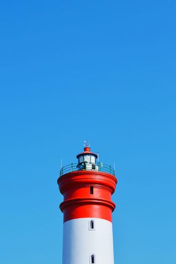High Section Of Lighthouse Against Clear Blue Sky