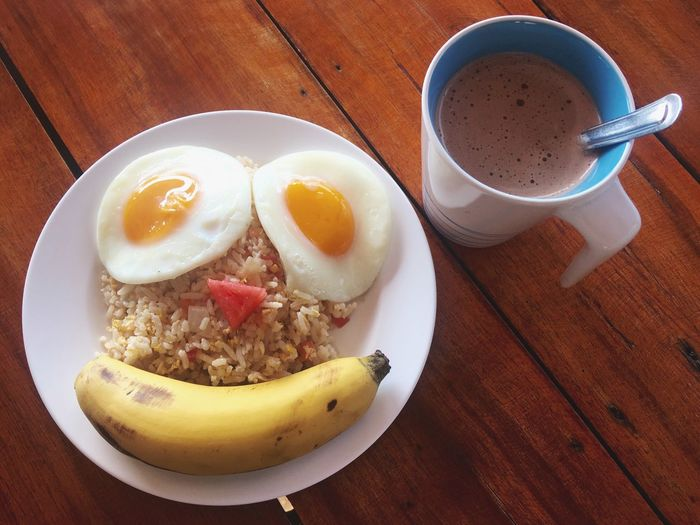 Morning breakfast with coffee, smile and enjoy to relaxation time Food And Drink Food Freshness Table Healthy Eating Drink Wellbeing Refreshment Ready-to-eat Plate High Angle View Breakfast Cup Coffee Coffee - Drink Egg Mug Indoors  Meal Fruit
