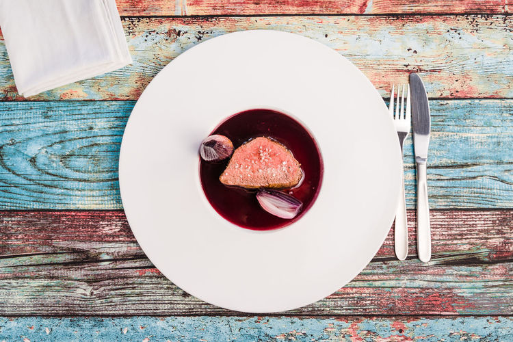 Tender duck meat with sauce (port wine and shallot) on white plate Food And Drink Food Still Life Freshness Ready-to-eat No People Plate Table Duck Portwine Port Porto Shallot Meat Shallow Dish Gourmet Tasty Tender Saucer