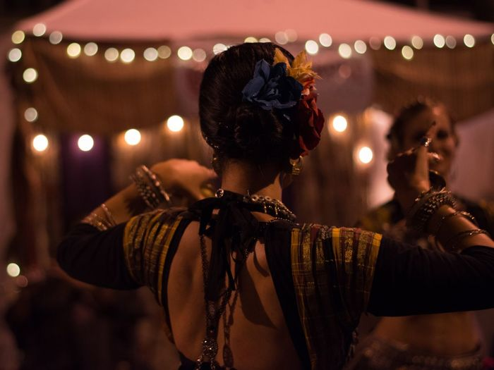 Women Performing Traditional Dance At Night