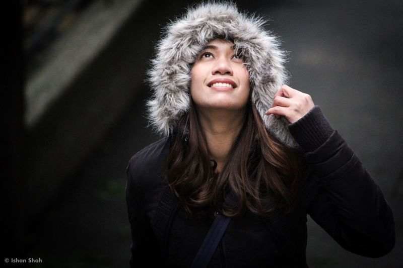 Portrait of mature woman standing in park during winter