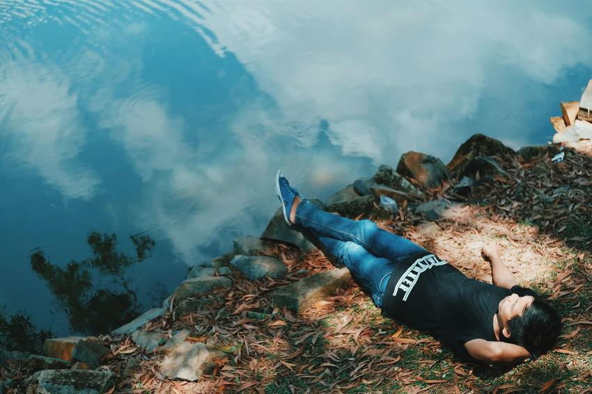 Lying down One Person Outdoors Day Shadows & Lights Beauty In Nature Summer Grass Lake Sunlight Eyeem On Week EyeEmNewHere EyeEmBestPics EyeEm Gallery EyeEm Masterclass EyeEm Indonesia EyeEm Best Shots