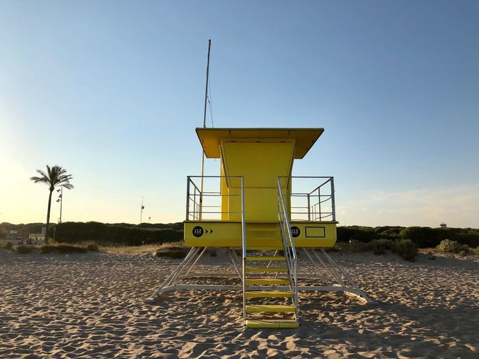 Yellow Sky Nature Safety Built Structure Architecture Land Protection No People Security Clear Sky Environment Outdoors Tower Beach Day Observation Point Non-urban Scene Lifeguard Hut Water