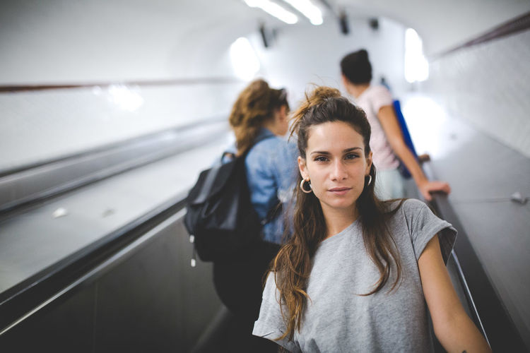 Adult Beautiful Woman Casual Clothing Focus On Foreground Front View Hair Hairstyle Indoors  Leisure Activity Lifestyles Mode Of Transportation People Portrait Public Transportation Real People Standing Transportation Travel Women Young Adult Young Women It's About The Journey