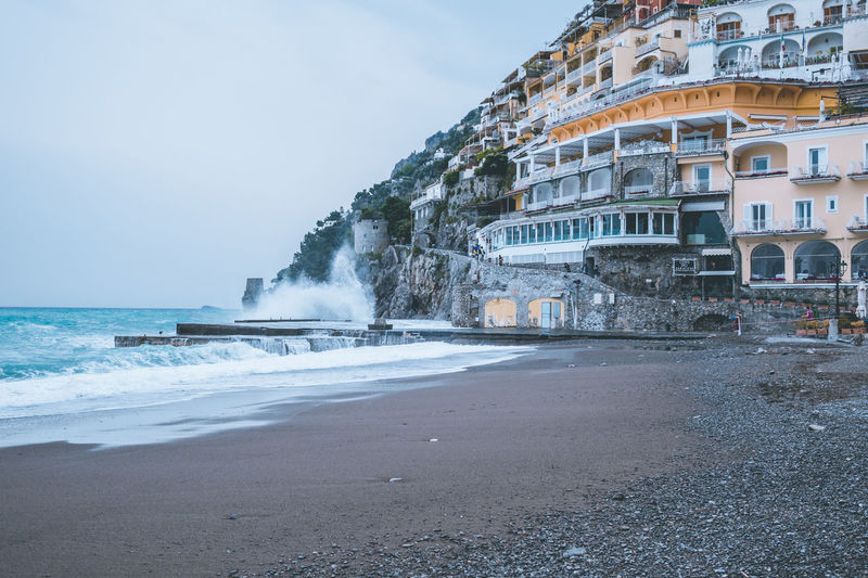 Beach in Positano, Italy. Water Sky Sea Architecture Built Structure Building Exterior Motion Nature Beach Land Day No People Beauty In Nature Building Outdoors Wave City Horizon Over Water Horizon Power In Nature Positano Europe Italy Amalfi Coast Seaside Amazing View Waves Blue Water Cliff Cityscape