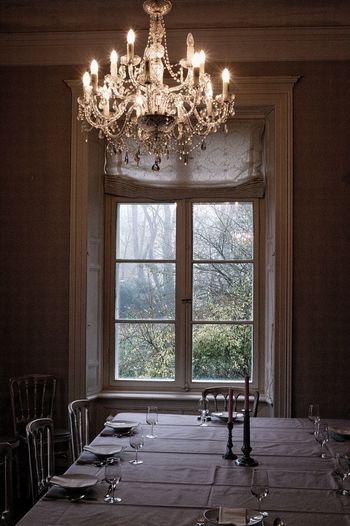 Indoors  Table Lighting Equipment Window Seat Chandelier Architecture Home Interior Absence Furniture Domestic Room Empty Luxury Dinner Time Autumn Mood