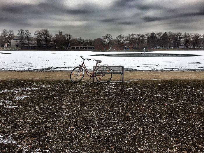 Bicycle Cold Temperature Sky Cloud - Sky Winter Weather Water Lake Tree Tranquility Nature Snow Transportation Mode Of Transport Outdoors Beauty In Nature Tranquil Scene Landscape Storm Cloud Day The Great Outdoors - 2017 EyeEm Awards Breathing Space