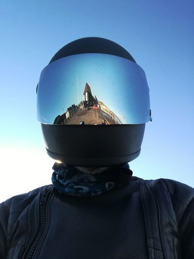 Reflection of cityscape in motorcycle helmet