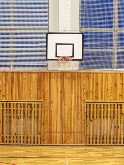 School gym with basketball board and basket. basketball hoop in the high school gym