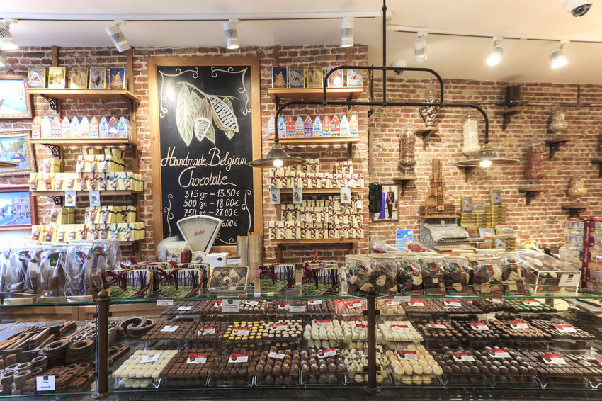 Bruges, Belgium - July 7, 2017: Close up of several chocolate sweets in a shop of Bruges Beer Belgium Brugge Chocolate Dijver Canal Duvel Flanders Panoramic View Provinciaal Hof West Flanders Aerial View Belfry Tower Bikes Bruges Europe Flower French Fries Holland Market Square Medieval Town Mussels