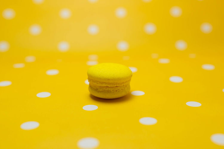 Macarons Backgrounds Brightly Lit Celebration Circle Close-up Colored Background Food Food And Drink Freshness Full Frame Geometric Shape Indoors  No People Pattern Polka Dot Selective Focus Shiny Spotted Still Life Studio Shot Yellow