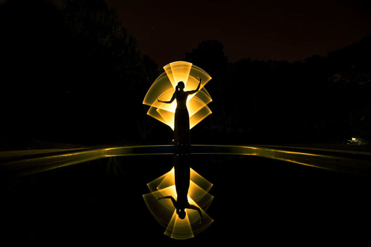 Reflection Full Length Adult Water One Person Adults Only One Man Only People Outdoors Only Men Young Adult Day Light Painting Photography Light Painting Lighting Equipment Lightpainting Astronomy Astrology Sign