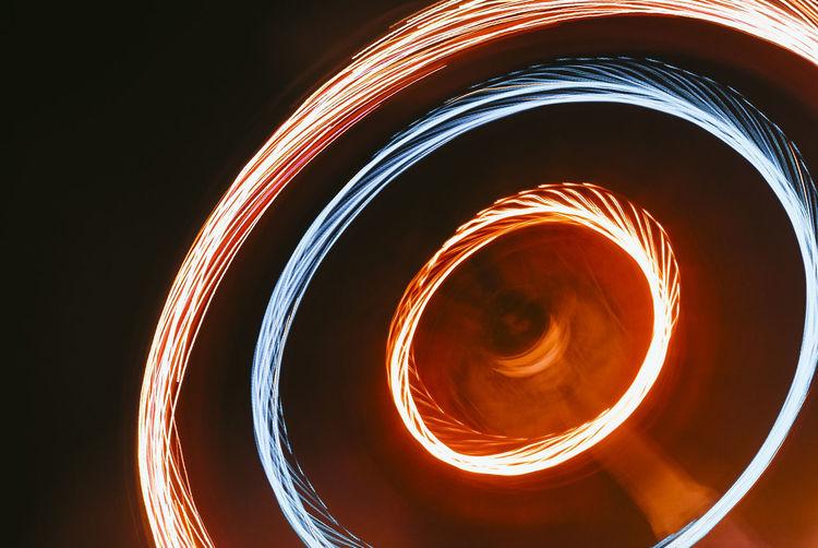 Long Exposure Motion Geometric Shape Night Burning Pattern Shape Glowing Orange Color Circle Fire - Natural Phenomenon Illuminated Spinning Fire Blurred Motion No People Spiral Abstract Creativity Light - Natural Phenomenon Black Background Wire Wool Funfair Bonfire Night Ferris Wheel