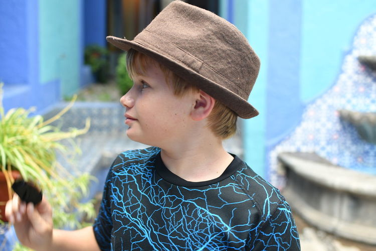Close-Up Of Boy Wearing Hat Standing Outdoors