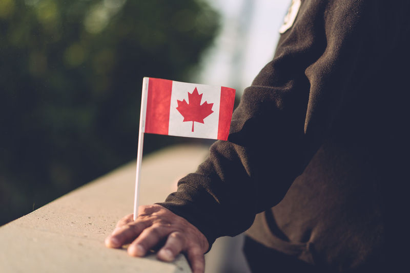 Canada Flag Close-up Day Flag Focus On Foreground Holding Human Hand Lifestyles One Person Outdoors People Real People Red