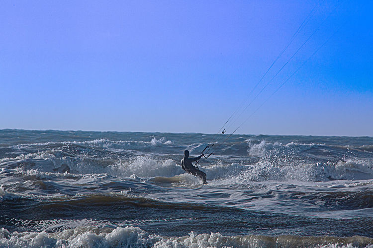 Sport Sea Water Aquatic Sport Surfing Adventure Sky Extreme Sports Wave One Person Nature Leisure Activity Clear Sky Horizon Horizon Over Water Men Kiteboarding Beauty In Nature Motion Skill  Outdoors Sankt Peter-Ording