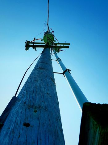 Dramatic Angles Tall Clear Sky Sky Outdoors Electric Pole Electric Lines Electric Wire Day Tall - High Power Line  Power Supply Powerlines The Architect - 2017 EyeEm Awards