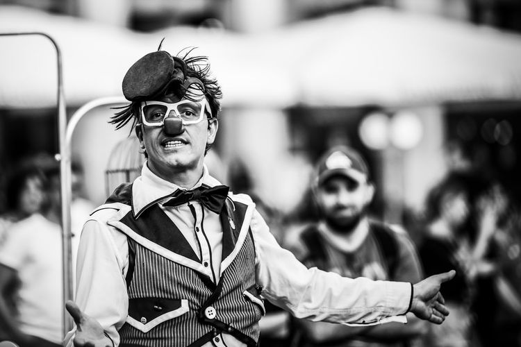 """""""The Entertainer"""" EyeEm Best Shots EyeEm Best Shots - Black + White EyeEmBestPics EyeEmNewHere Arts Culture And Entertainment Clothing Day Focus On Foreground Front View Incidental People Lifestyles Looking At Camera Outdoors People Performance Portrait Real People Smiling Standing Young Adult Young Men The Art Of Street Photography My Best Photo The Portraitist - 2019 EyeEm Awards The Portraitist - 2019 EyeEm Awards"""